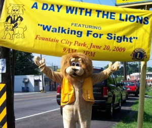 Lion Paws under the Day with the Lions Sign
